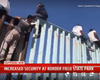 Migrant Caravan Reach Border & Climb Atop Fencing Effortlessly (Video)