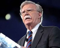 John Bolton Sells Out – America Pays The Price